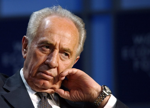 File picture dated 24 January 2003 shows former Israeli Prime Minister Shimon Peres at the World Economic Forum in Davos, Switzerland. Israel's opposition Labour party voted 04 February 2004 for Peres to continue as leader for another two years, party sources said. The 80-year-old Nobel peace prize winner won backing of around 60 percent of members at a meeting of his party's convention in Tel Aviv to remain as head of the faction until December 2005. Peres, a leading figure on the Israeli political scene for nearly half a century, was elected temporary leader of the party for just one year last June after the party's general election debacle in January. AFP PHOTO/ERIC FEFERBERG